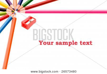Frame made of colorful pencils, shallow depth of field with focus on the Your sample text