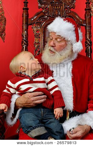 Baby Looking Up At Santa