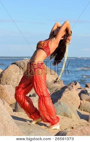 Woman in indian dress dancing with sabre
