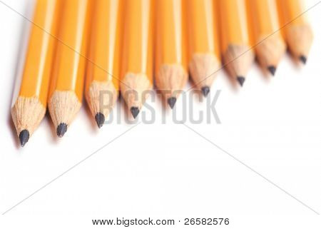 closeup photography of some pencils on white paper