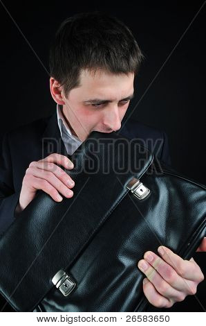 young man eating suitcase