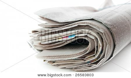Stack of rolled newspaper