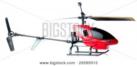 Toy helicopter over white background. Focus on red cockpit.