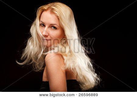 Blonde woman over dark background