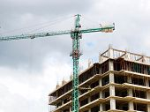 Construction Site. Construction Site With Crane And Building. Self-erection Crane Near Building. poster