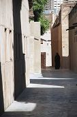image of burka  - Lady in Burka in the historic Batiskiya near the Dubai Creek  - JPG