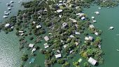 Looking Down On Flooded Homes And Houses Above Aerial Drone View Above Entire Community Damaged And  poster