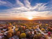 Sunset In The Fall Over The Suburban Neighborhood poster