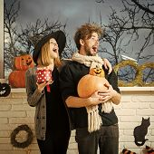Halloween Woman In Witch Hat With Gift Box. Surprised Couple In Love Standing At Window With Autumn  poster