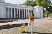 Traveler Tourist Woman In Yellow Summer Casual Clothes Hat With Suitcase Holding City Map Looking As poster