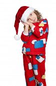Portrait of Little girl in pajamas and santa hat over white background