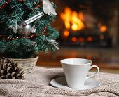Cup Of Tea Or Coffee, Woolen Knitted Things Plaid And Christmas Decorations Near Cozy Fireplace Back poster