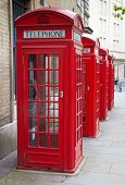 A group of typical red London phone cabins