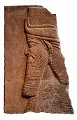 stock photo of babylonia  - Isolated relief of an ancient assyrian king - JPG