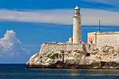 stock photo of el morro castle  - The famous fortress and lighthouse of El Morro in the entrance of Havana bay - JPG