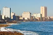 stock photo of malecon  - The shoreline of Havana with the famous promenade of El Malecon in a beautiful summer day - JPG