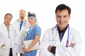 image of medical doctors  - Friendly caring team of medical doctors surgeons healthcare professionals - JPG