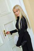 picture of open door  - Woman open door - JPG