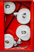 picture of firehose  - Fire hoses packed inside of red emergency box - JPG