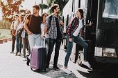 Group Of Young People Boarding On Travel Bus. Happy Travelers Standing In Queue Holding Luggage Wait poster