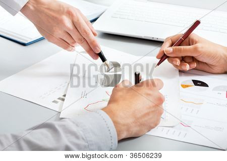 Close-up of hands of business people at work in the office