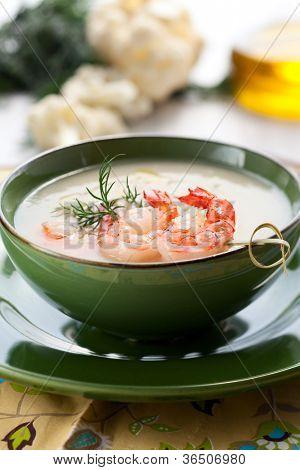 Cauliflower cream soup with skewered prawns