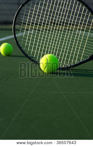 Tennis Balls and Racket on the Court with room for copy