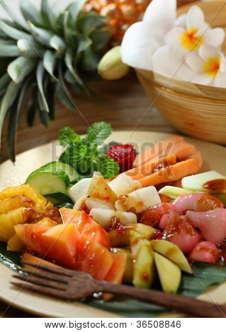 Rujak is an Indonesian traditional fruit salad dish. A spicy fruit salad made with a mixture of fruits