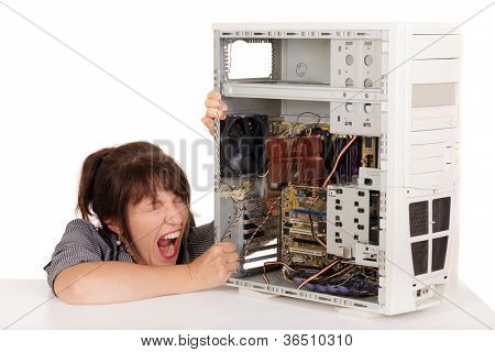 woman in furious crisis with broken computer