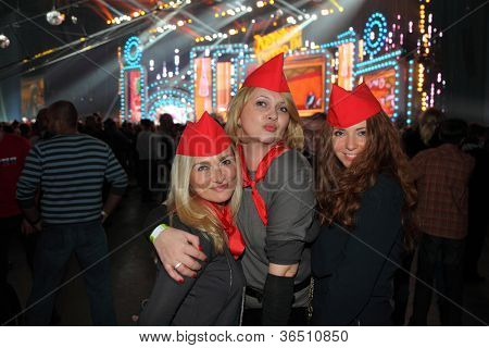 MOSCOW - DEC 17: Happy girls pose in hall near other fans on concert of Legend RetroFM in Sports complex Olimpiyskiy, on Dec 17, 2011 in Moscow, Russia. Capacity of Olympic Complex is 25000 people.