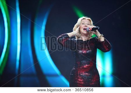 MOSCOW - DEC 17: Lyubov Uspenskaya sings on scene during concert of Legend RetroFM in Sports complex Olimpiyskiy, on Dec 17, 2011 in Moscow, Russia. L.Uspenskaya was born February 24, 1954 in Kiev.