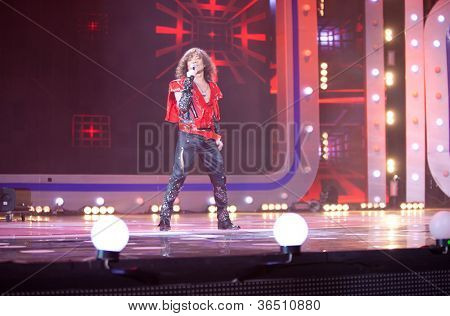 MOSCOW - DEC 17: Valery Leontiev sing on scene with display during concert of Legend RetroFM in Sports complex Olimpiyskiy, Dec 17, 2011, Moscow, Russia. V.Leontiev In 1974 became soloist of Dreamers.