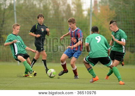 KAPOSVAR, HUNGARY - SEPTEMBER 1: Viktor Somogyi (9) in action at the Hungarian National Championship under 18 game between Kaposvar (green) and Videoton (blue) September 1, 2012 in Kaposvar, Hungary.