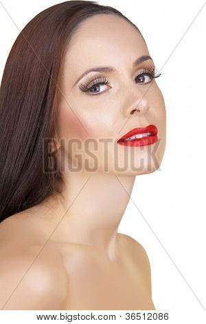 beautiful woman with long brown hair wearing natural make-up and long false eyelashes and red lips isolated on white