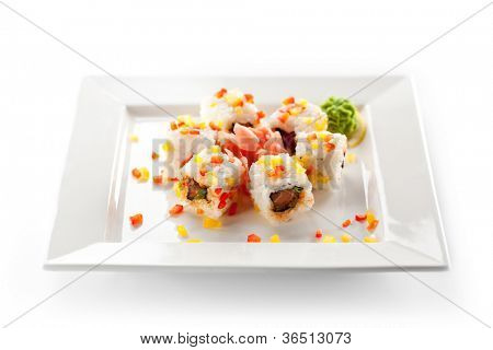 Fish Maki Sushi - Roll with Salmon and Lettuce inside. Sliced Paprika ouside