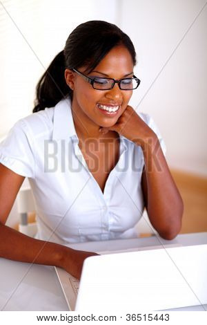 Young Woman Browsing The Internet On Laptop