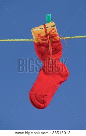 baby socks on clothesline to dry. blue sky.