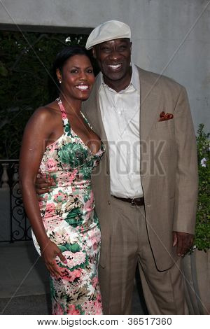 LOS ANGELES - JUL 24: Omarosa Manigault-Stallworth, Michael Clarke Duncan at the 12th Annual HollyRod Foundation DesignCare Event,Ron Burkle's Green Acres Estate on July 24, 2010 in Beverly Hills, CA
