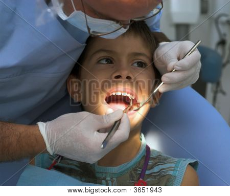 Young Boy Is Having His Cavities Fixed By A Dentist