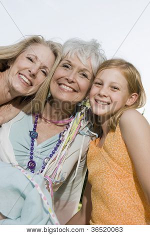Women and grand daughter smiling together