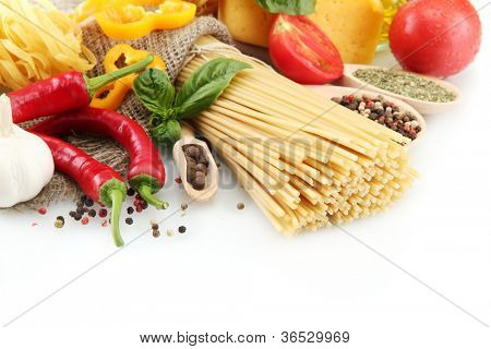 Pasta spaghetti, vegetables and spices, isolated on white