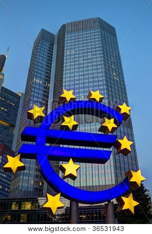 FRANKFURT, GERMANY - AUG 21: The Famous Big Euro Sign at the European Central Bank on August 21, 2012 in Frankfurt, Germany. The bank was established by the Treaty of Amsterdam in 1998.