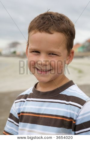 Pretty Boy Smiling On Beach