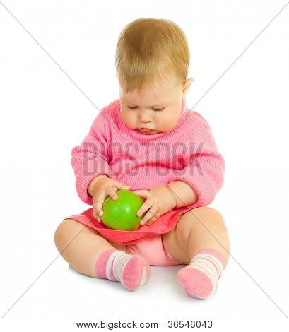 Small baby in red with green apple