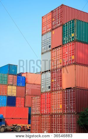 Stack of Cargo Containers at sunrise in an intermodal yard