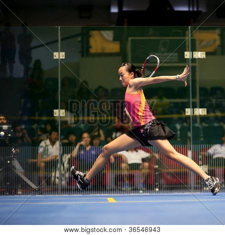KUALA LUMPUR - SEPTEMBER 01: Low Wee Wern (red) returns a shot at the TC Malaysian National Squash Championships 2012 played at the Arena Nicol David, Malaysia on September 01, 2012.