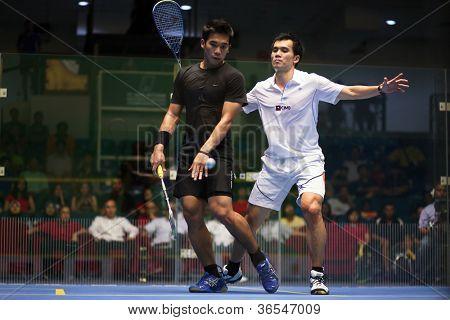 KUALA LUMPUR - SEPTEMBER 02: Ong Beng Hee (white) takes on Nafiizwan Adnan in the men's finals of the Malaysian National Squash Championships played in Kuala Lumpur, Malaysia on September 02, 2012.