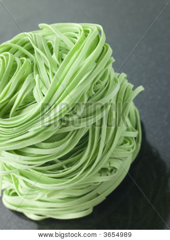 Stack Of Spinach Noodles On A Black Background