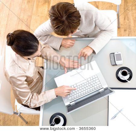 Businesswomen Using Laptop Computer