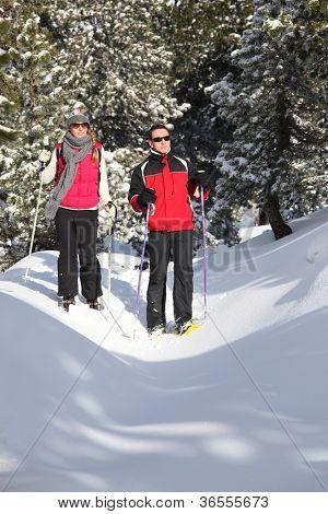 Couple snow-shoeing